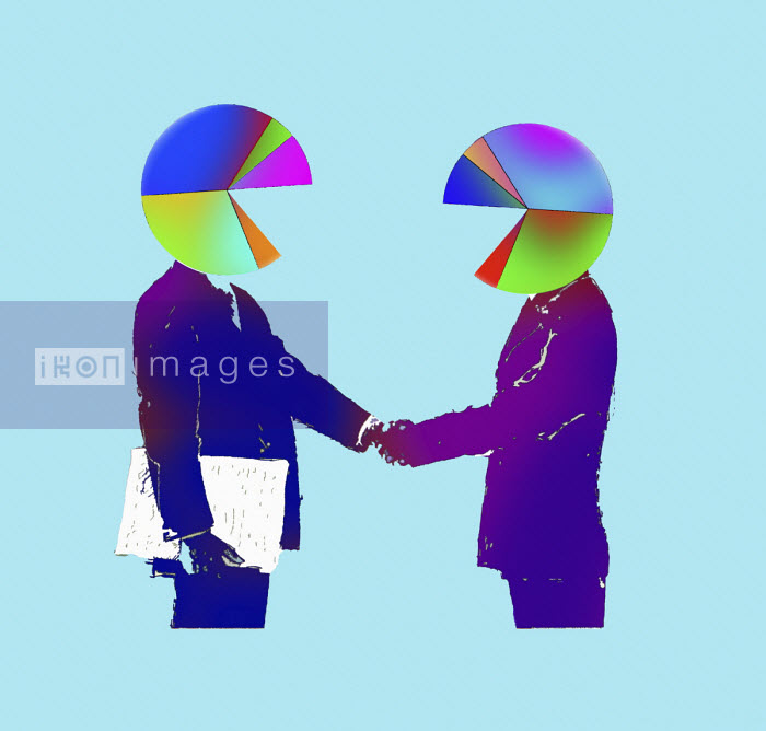 Businessmen with pie chart heads shaking hands - Gary Waters
