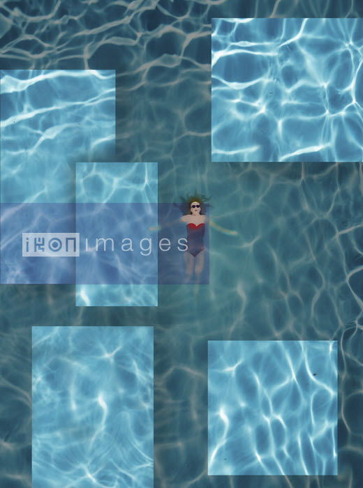 Woman floating in rippling swimming pool - Gary Waters