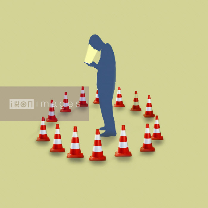 Man addicted to phone on own surrounded by traffic cones - Gary Waters