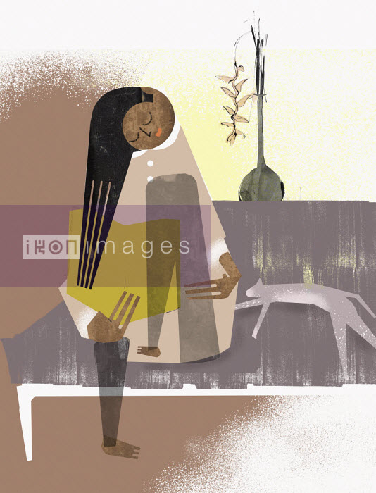 Woman relaxing reading on sofa - Eddie Edwards