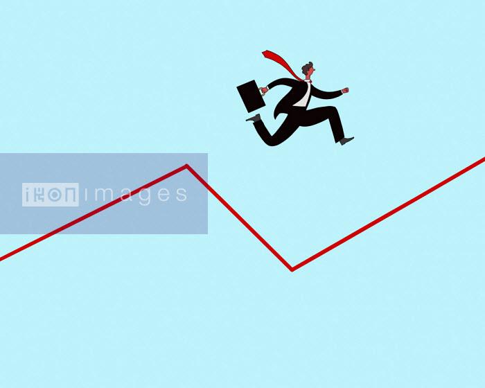 Businessman jumping across dip in graph - Benjamin Baxter