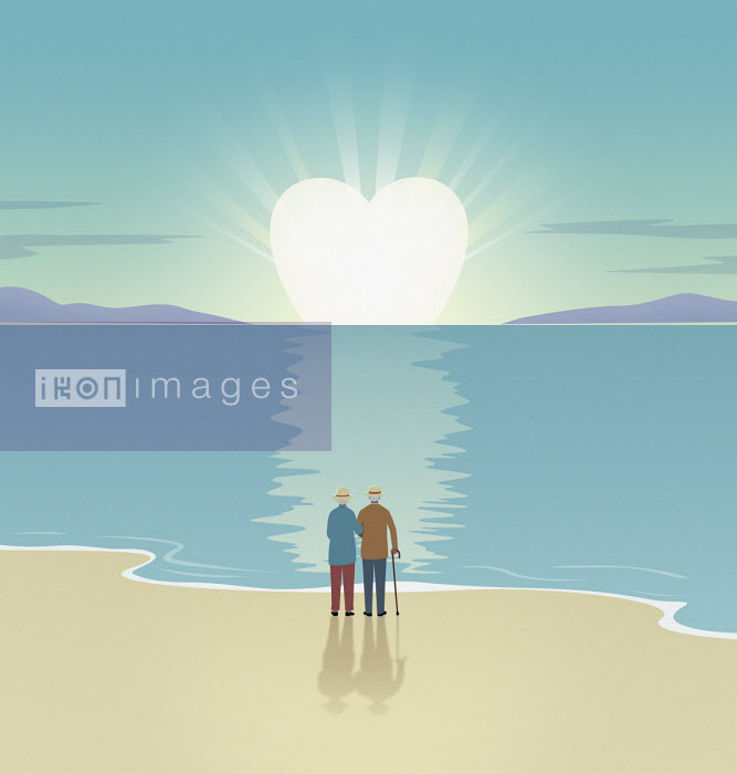 Elderly couple watching heart shaped sun setting - Mark Airs