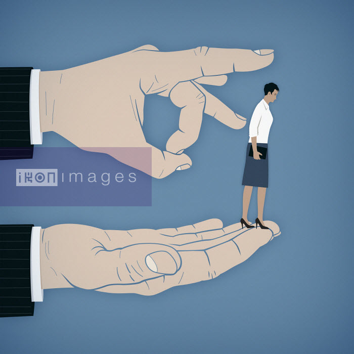 Large finger flicking businesswoman off hand - Mark Airs