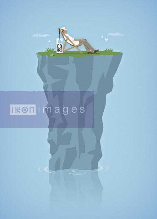 Man relaxing on top of tiny isolated rocky island peak - Mark Airs
