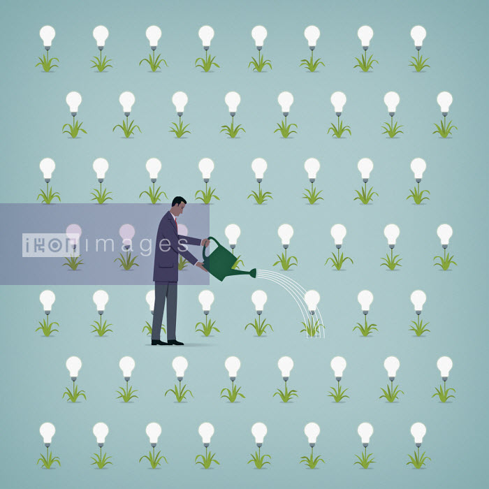 Businessman watering rows of light bulb plants - Mark Airs