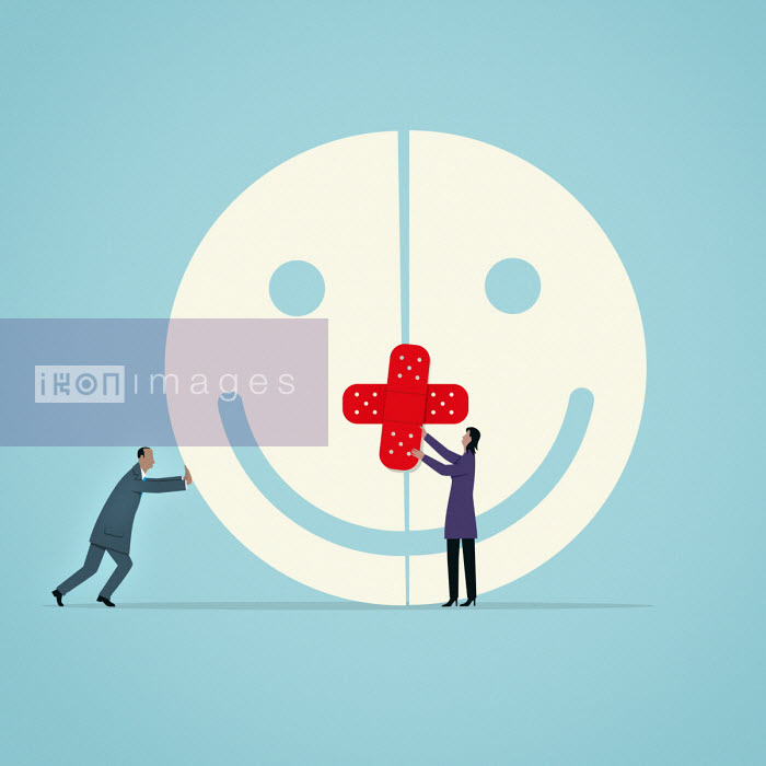 Business people bandaging enormous smiley face - Mark Airs
