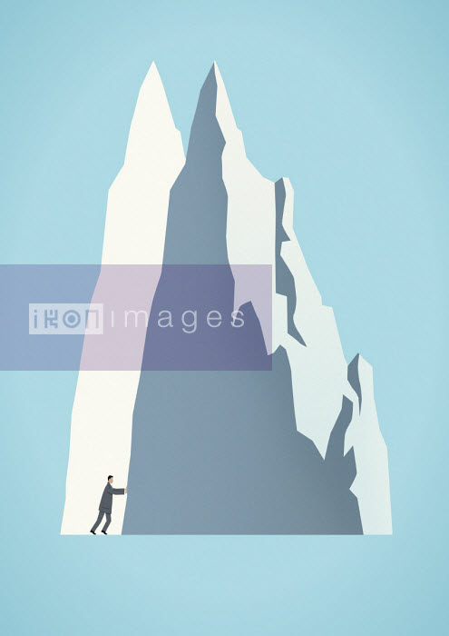 Businessman moving mountain - Mark Airs