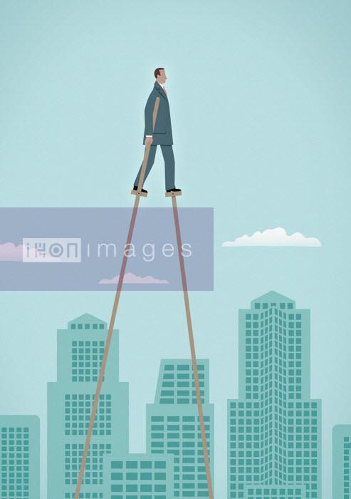 Businessman on stilts walking above city - Mark Airs