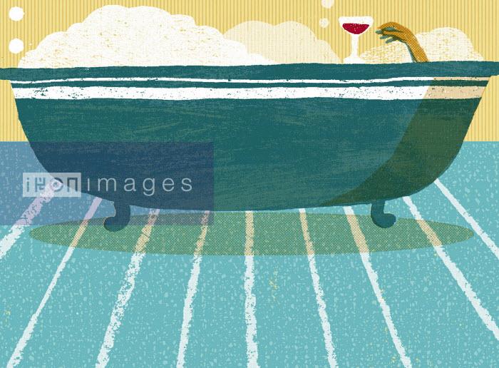 Relaxing in bubble bath with glass of wine - Daniel Haskett