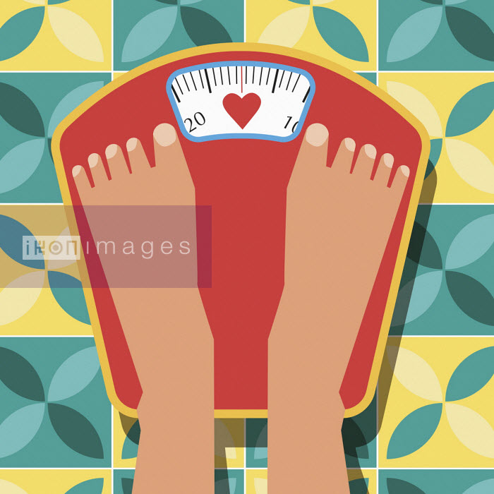 Feet on bathroom scales with heart shape on dial - Verónica Grech