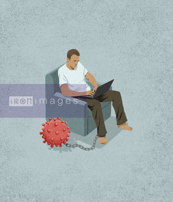 Man working from home with coronavirus ball and chain - John Holcroft