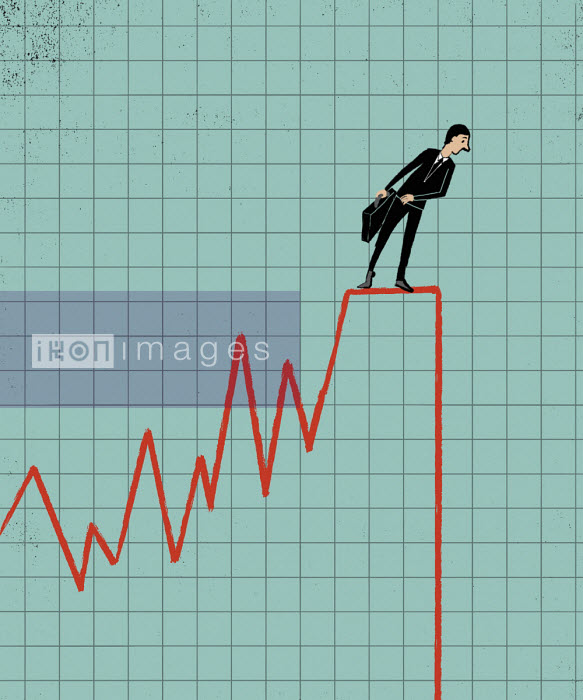 Businessman on graph cliff edge - Michael Villegas