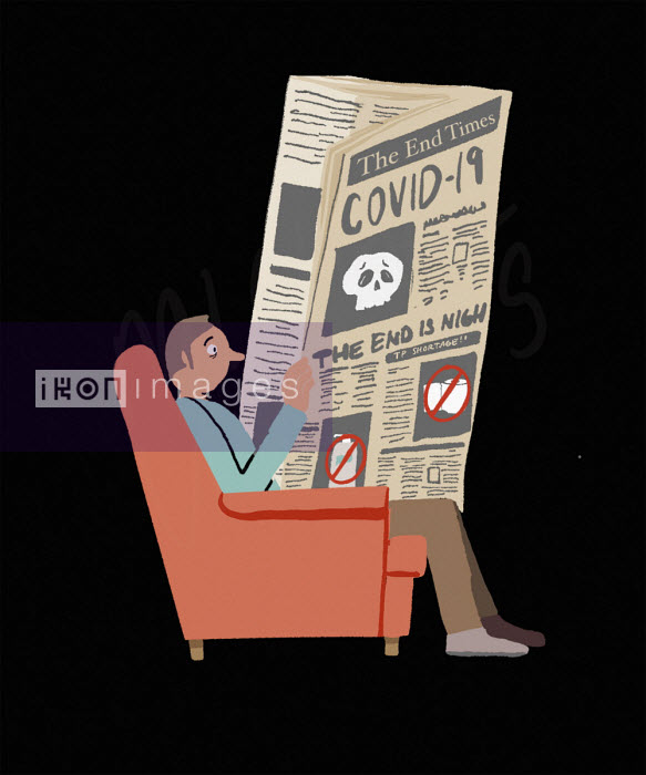 Worried man reading bad news about coronavirus in newspaper - Michael Villegas