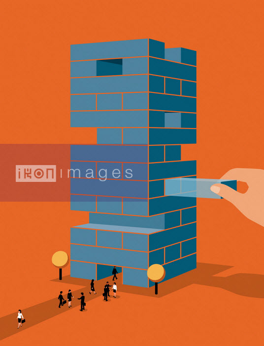 Hand removing building blocks from office tower - Patrick George