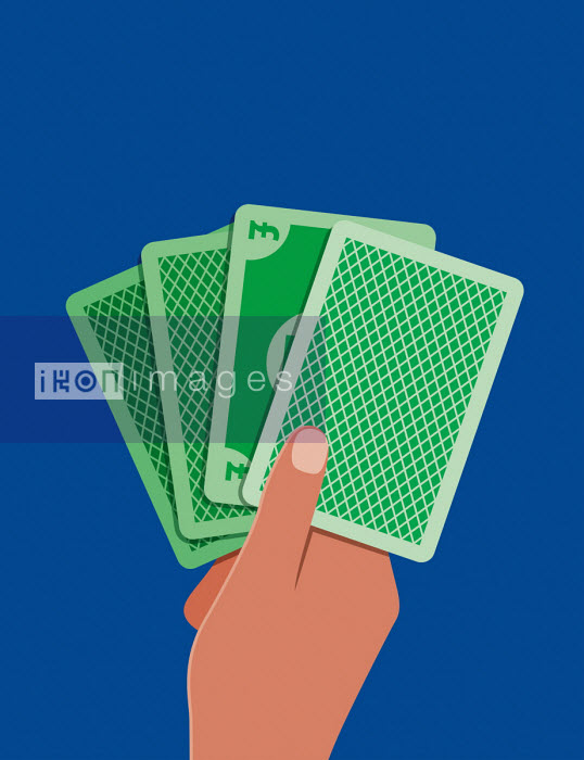 Hand of cards including British pound card - Patrick George