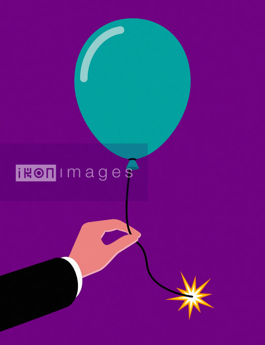 Businessman's hand holding balloon with lit fuse - Patrick George