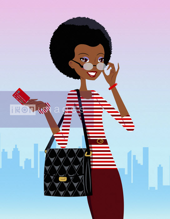 Happy woman holding credit card in city - Ade Akinrujomu