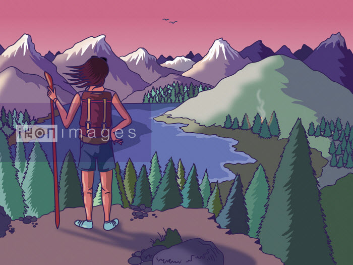 Hill walker looking at mountain view - Ollie Brown