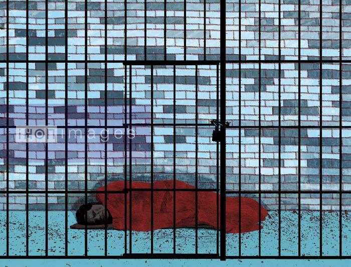 Homeless person asleep on floor behind bars - Rebecca Hendin