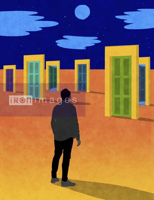 Man with choice of doors in desert - Rebecca Hendin