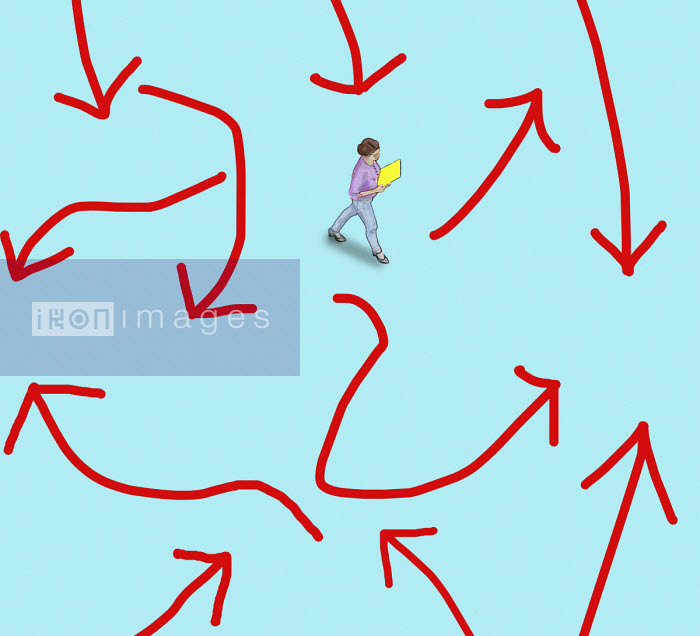 Overhead view of businesswoman surrounded by confusing arrows - Gary Waters