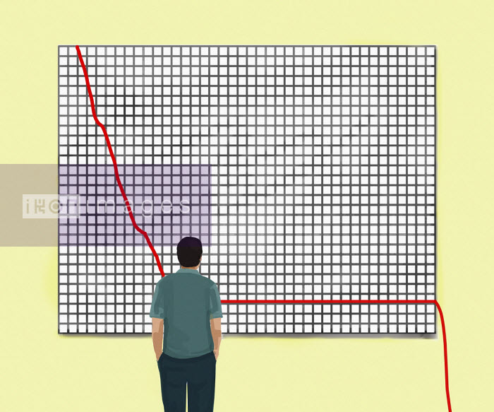 Businessman looking at line graph falling off chart - Gary Waters