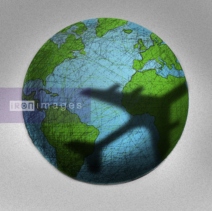 Plane casting shadow over globe - Gary Waters