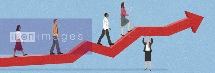 Businesswoman holding up arrow for colleagues to move up - John Holcroft