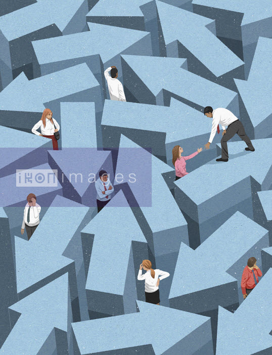 Businessman helping colleague escape from labyrinth of arrows - John Holcroft
