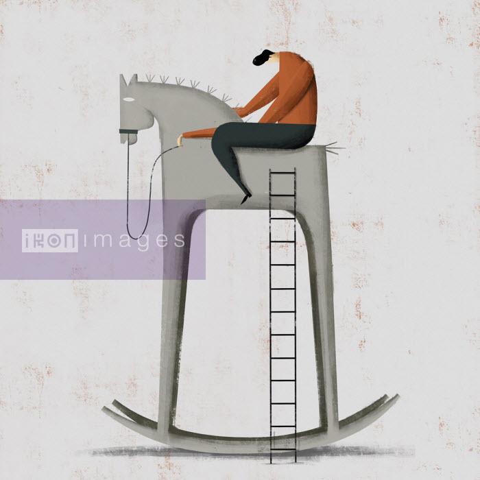 Dejected man on top of tall rocking horse - Josep Serra
