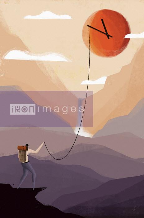 Hiker holding on to clock hands on sun over mountain landscape - Josep Serra