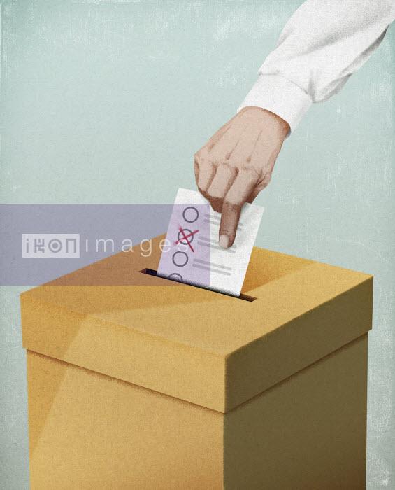 Hand putting voting paper in ballot box - Hendrik Dahl