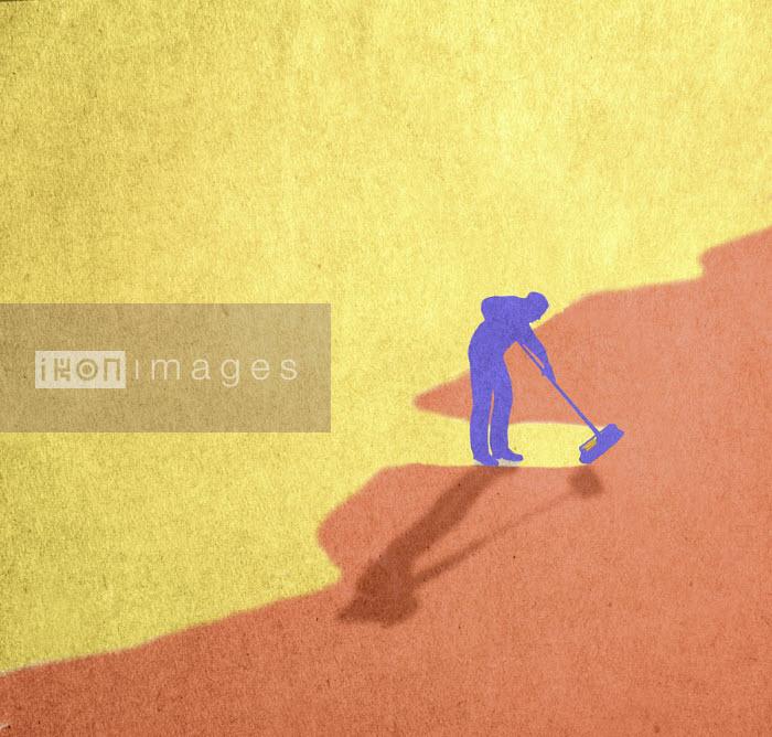 Man struggling to sweep up encroaching tide - Gary Waters