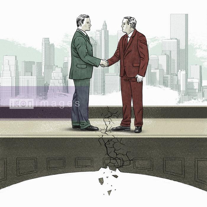 City businessmen shaking hands on crumbling bridge - Thomas Kuhlenbeck