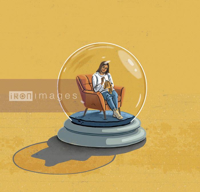 Woman sitting at home inside snow globe - Eva Bee