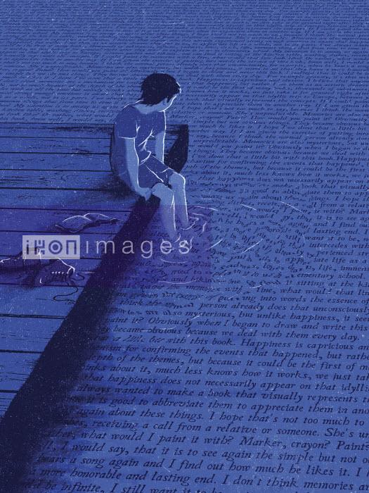 Boy dangling feet in water covered in words - Daniel Liévano