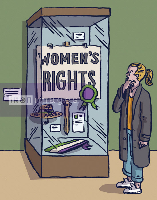 Girl looking at Women's Rights display in museum cabinet - Dom McKenzie