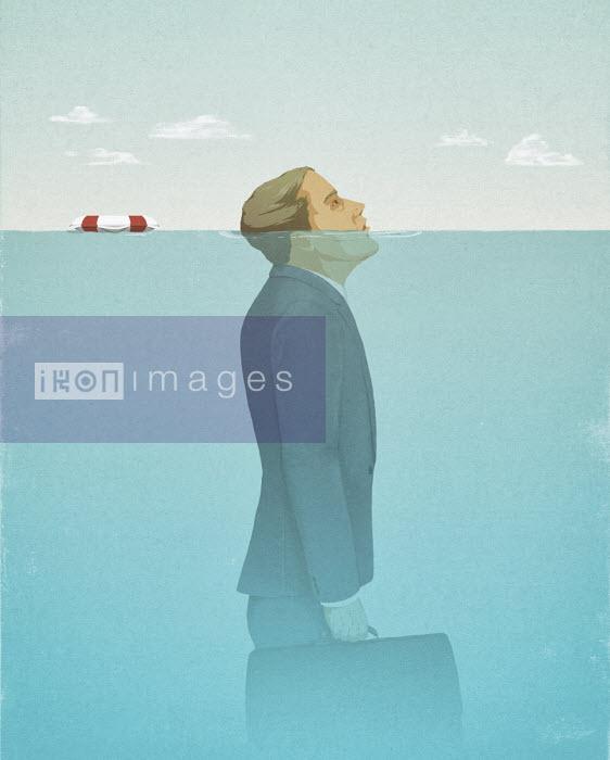 Businessman struggling to keep head above water - Hendrik Dahl
