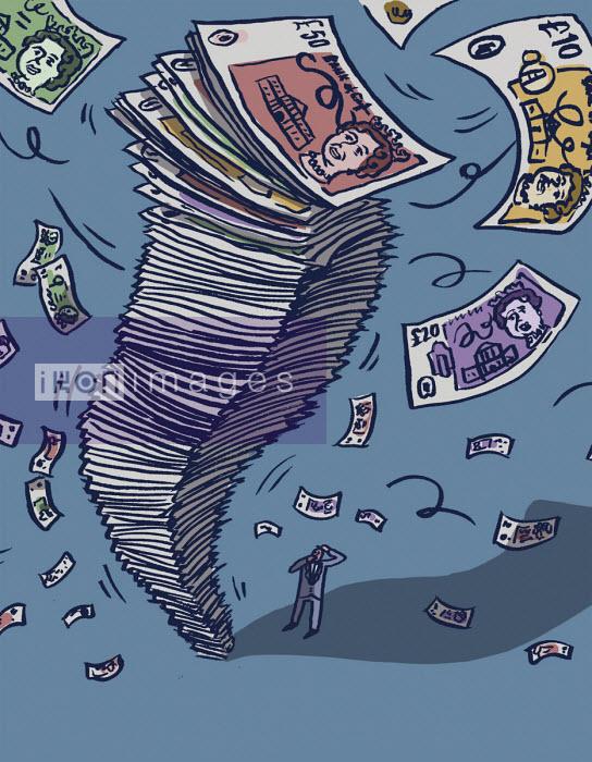 Anxious businessman watching pile of money blow away - Dom McKenzie