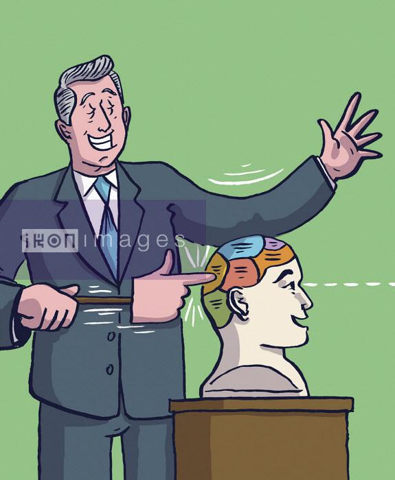 Businessman pressing area of brain of happy man - Dom McKenzie