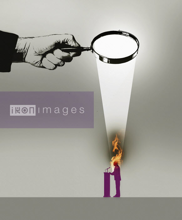 Politician burning under rays of magnifying glass - Gary Waters