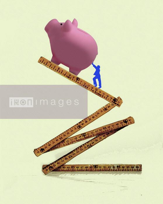 Man pushing piggy bank up ruler - Gary Waters