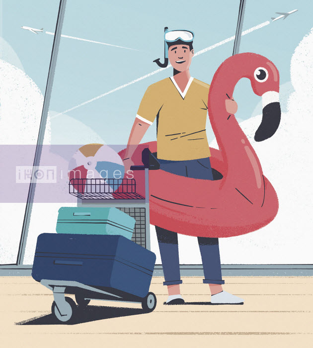 Man going on beach holiday with inflatable at airport - Paul Reid