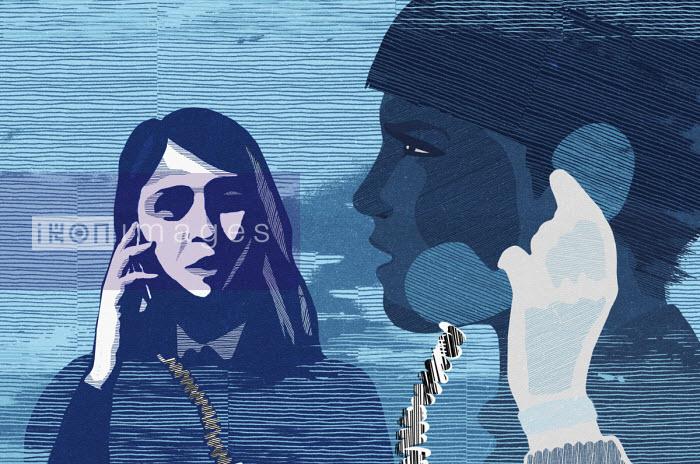 Teenage boy and girl chatting on landline telephone - Chris Keegan