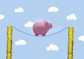 Piggy bank on tightrope between piles of money